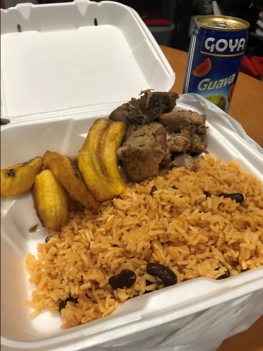 Pernil platter with maduros and yellow rice